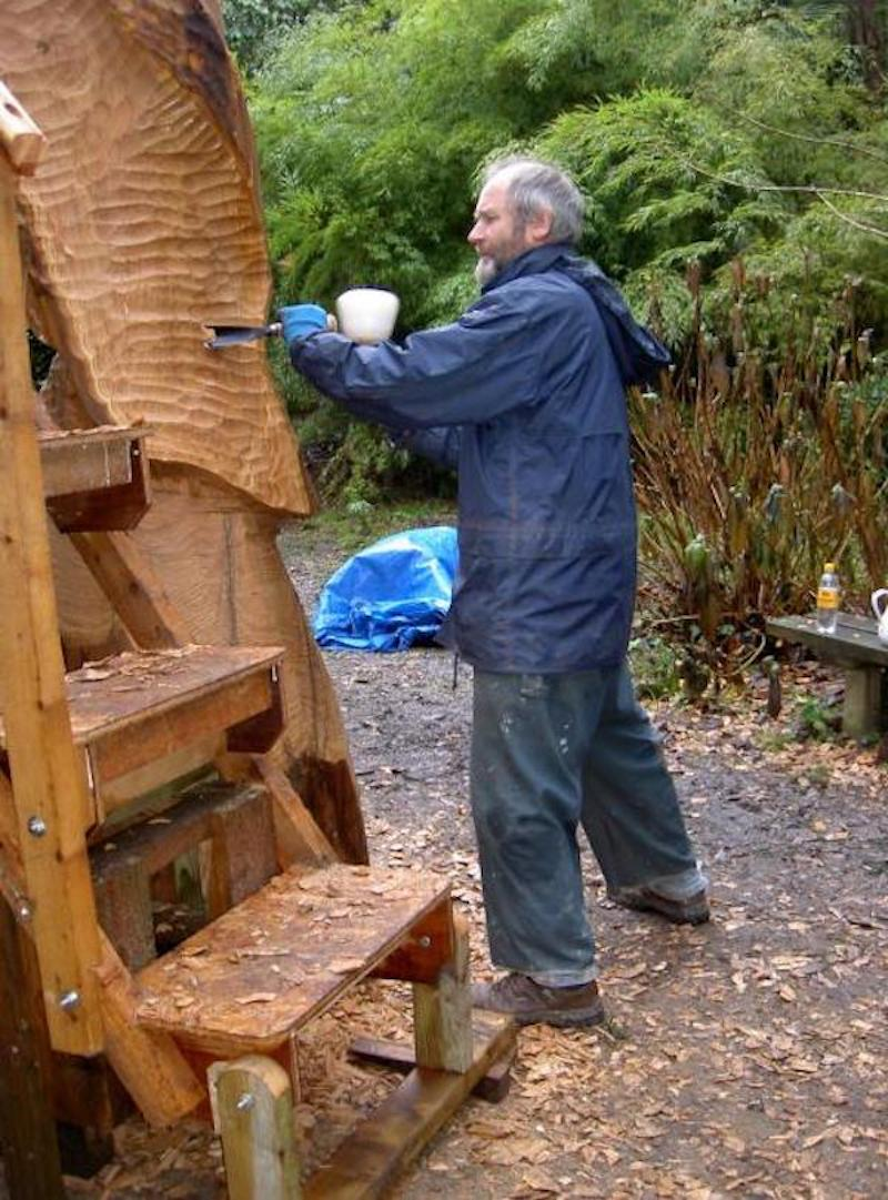 Peter in the early stages of carving a wood sculpture
